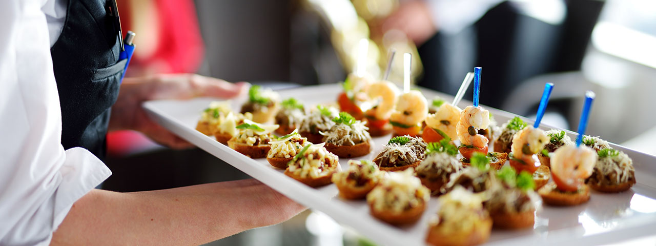 Man serving canapes during an event